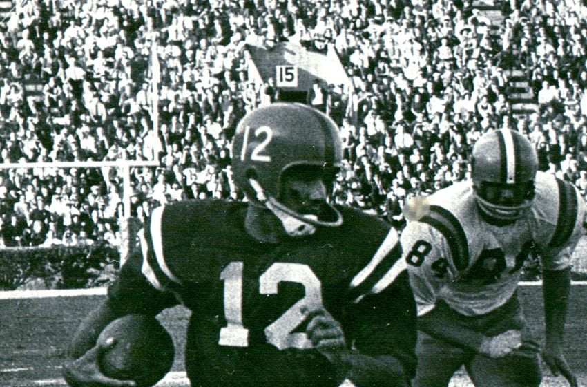 Ole Miss quarterback Jim Weatherly runs for yardage in 1963 against LSU in the Rebels' 37-7 victory in Baton Rouge. Weatherly, who went on to become a Hall of Fame songwriter, has a new book out