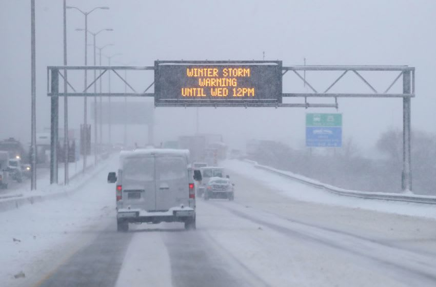 A WisDOT sign warns drivers of a winter storm warning on I-43 Southbound just south of the Marquette interchange in Milwaukee on Wednesday, Jan. 23, 2019. A steady overnight snow covered southern Wisconsin with several inches of snow, but the National Weather Service is saying the worst of the storm will hit the area between 5 and 11 a.m., making for a very challenging morning commute. Photo by Mike De Sisti / Milwaukee Journal Sentinel Snow24 Snow 01459
