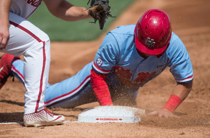 Jun 10, 2019; Fayetteville, AR, USA; Mississippi Rebels designated hitter Knox Loposer (4) gets back to first base safely during the game against the Arkansas Razorbacks at Baum-Walker Stadium. Mandatory Credit: Brett Rojo-USA TODAY Sports