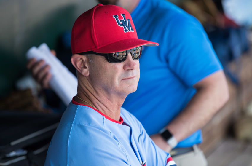 Jun 10, 2019; Fayetteville, AR, USA; Mississippi Rebels head coach Mike Bianco looks on from the dugout during the game against the Arkansas Razorbacks at Baum-Walker Stadium. Mandatory Credit: Brett Rojo-USA TODAY Sports