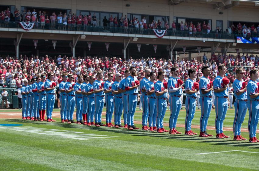 Jun 8, 2019; Fayetteville, AR, USA; Mississippi Rebels players and coaches line up for the National Anthem before their game against the Arkansas Razorbacks at Baum-Walker Stadium. Mandatory Credit: Brett Rojo-USA TODAY Sports