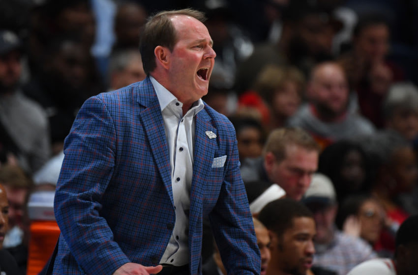 Mar 11, 2020; Nashville, Tennessee, USA; Mississippi Rebels head coach Kermit Davis yells from the bench during the first half against the Georgia Bulldogs at Bridgestone Arena. Mandatory Credit: Christopher Hanewinckel-USA TODAY Sports