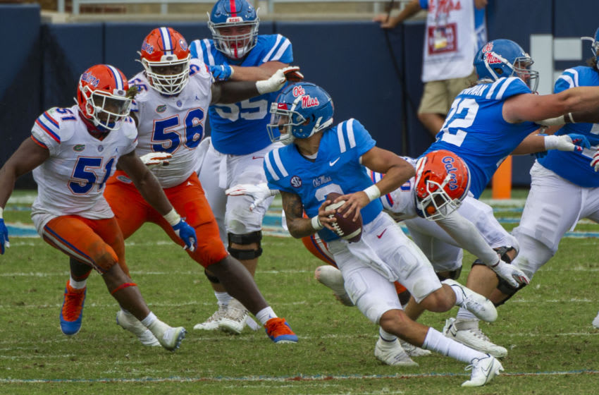 Sep 26, 2020; Oxford, Mississippi, USA; Mississippi Rebels quarterback Matt Corral (2) scrambles out of the pocket against the Florida Gators during the second half at Vaught-Hemingway Stadium. Mandatory Credit: Justin Ford-USA TODAY Sports