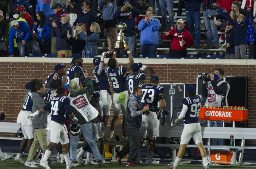 Nov 28, 2020; Oxford, Mississippi, USA; Mississippi Rebels players celebrate after the game against the Mississippi State Bulldogs at Vaught-Hemingway Stadium. Mandatory Credit: Justin Ford-USA TODAY Sports