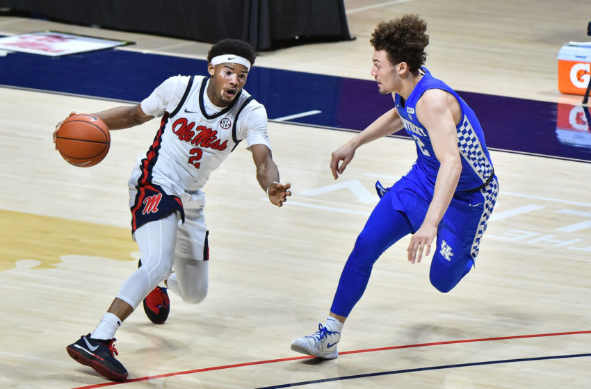 Mar 2, 2021; Oxford, Mississippi, USA; Mississippi Rebels guard Devontae Shuler (2) handles the ball against Kentucky Wildcats guard Devin Askew (2) during the second half at The Pavilion at Ole Miss. Mandatory Credit: Justin Ford-USA TODAY Sports