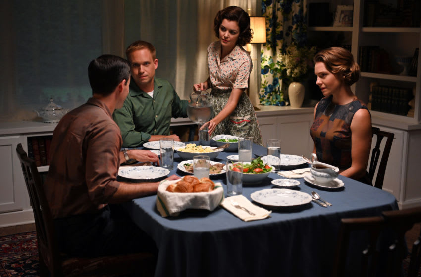 John Glenn played by Patrick J. Adam and Annie Glenn played by Nora Zehetner host Gordon Cooper played by Colin O'Donoghue and Trudy Cooper played by Eloise Mumford for dinner in National Geographic's THE RIGHT STUFF streaming on Disney+. Image courtesy National Geographic, Disney+
