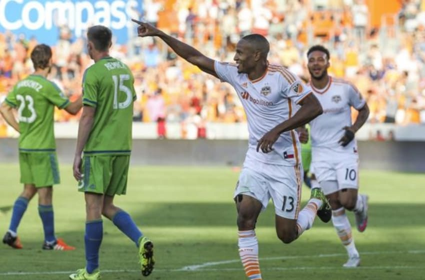 Oct 18, 2015; Houston, TX, USA; Houston Dynamo midfielder Ricardo Clark (13) celebrates after scoring a goal during the second half against the Seattle Sounders FC at BBVA Compass Stadium. Mandatory Credit: Troy Taormina-USA TODAY Sports