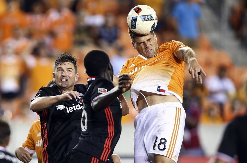 Jun 18, 2016; Houston, TX, USA; Houston Dynamo defender David Horst (18) heads the ball during the second half against D.C. United at BBVA Compass Stadium. The Dynamo and D.C. United played to a 0-0 tie. Mandatory Credit: Troy Taormina-USA TODAY Sports