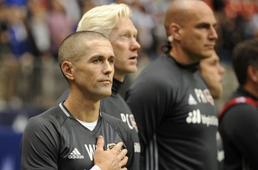 May 28, 2016; Vancouver, British Columbia, CAN; Houston Dynamo Assistant Coach Wade Barrett stands with Sports Performance Director/Fitness Coach Paul Caffrey and Goalkeeper Coach Paul Rogers before the start of the first half against the Vancouver Whitecaps at BC Place. Mandatory Credit: Anne-Marie Sorvin-USA TODAY Sports