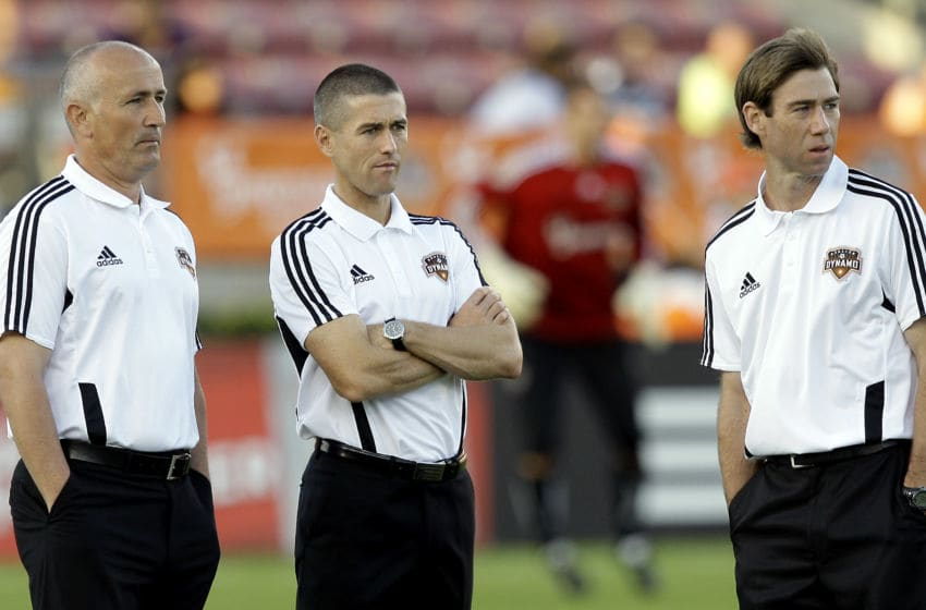 HOUSTON, TX - MARCH 19: (L - R) Houston Dynamo head coach Dominic Kinnear, assistant coach Wade Barrett, and assistant coach Steve Ralston watch warmups before a game against the Philadelphia Union at Robertson Stadium on March 19, 2011 in Houston, Texas. (Photo by Bob Levey/Getty Images)