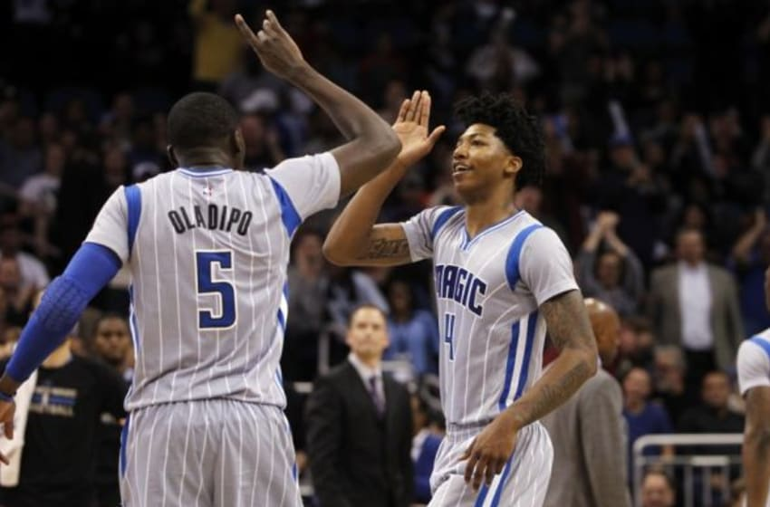 Jan 14, 2015; Orlando, FL, USA; Orlando Magic guard Victor Oladipo (5) and guard Elfrid Payton (4) high five after Oladipo dunked against the Houston Rockets during the second half at Amway Center. Orlando Magic defeated the Houston Rockets 120-113. Mandatory Credit: Kim Klement-USA TODAY Sports