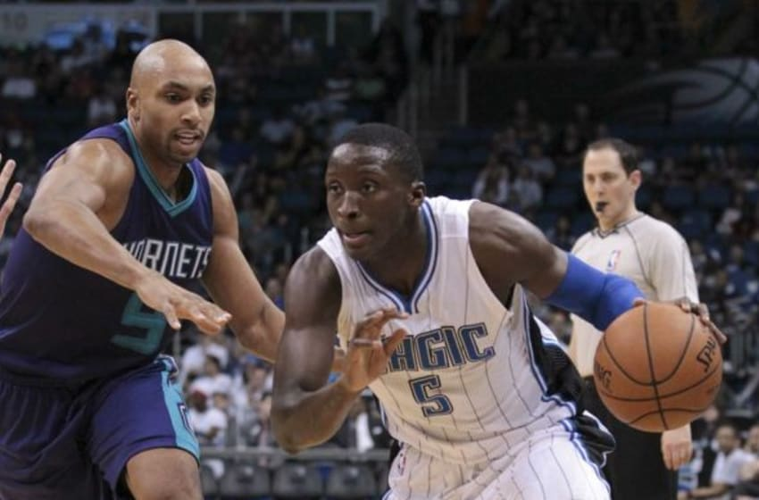 Jan 3, 2015; Orlando, FL, USA; Orlando Magic guard Victor Oladipo (5) drives past Charlotte Hornets guard Gerald Henderson (9) during the third quarter of an NBA basketball game at Amway Center. The Hornets won 98-90. Mandatory Credit: Reinhold Matay-USA TODAY Sports