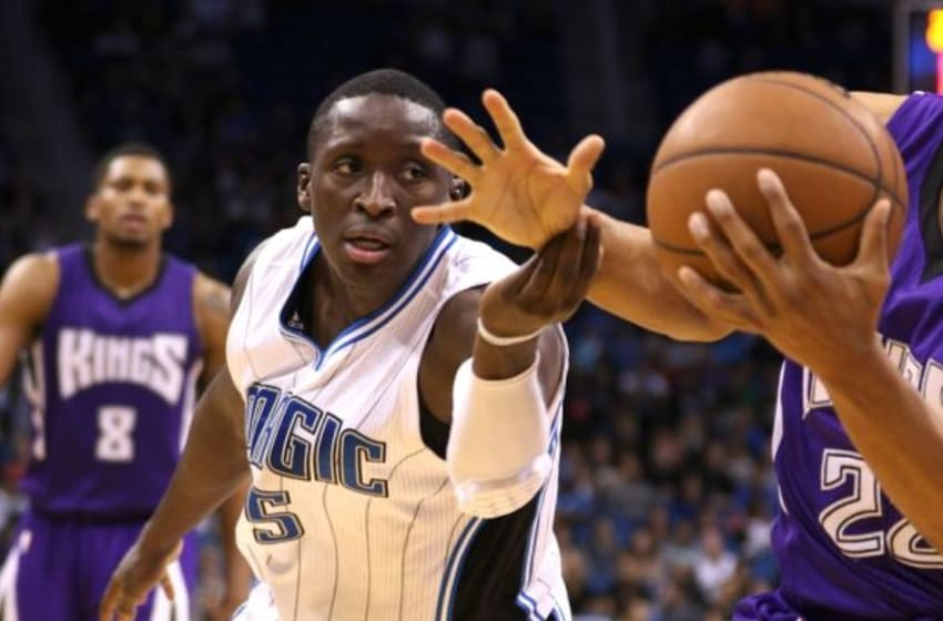 Mar 6, 2015; Orlando, FL, USA; Orlando Magic guard Victor Oladipo (5) tries to strip the ball from Sacramento Kings guard Andre Miller (22) during the second half of an NBA basketball game at Amway Center. The Magic won 119-114. Mandatory Credit: Reinhold Matay-USA TODAY Sports
