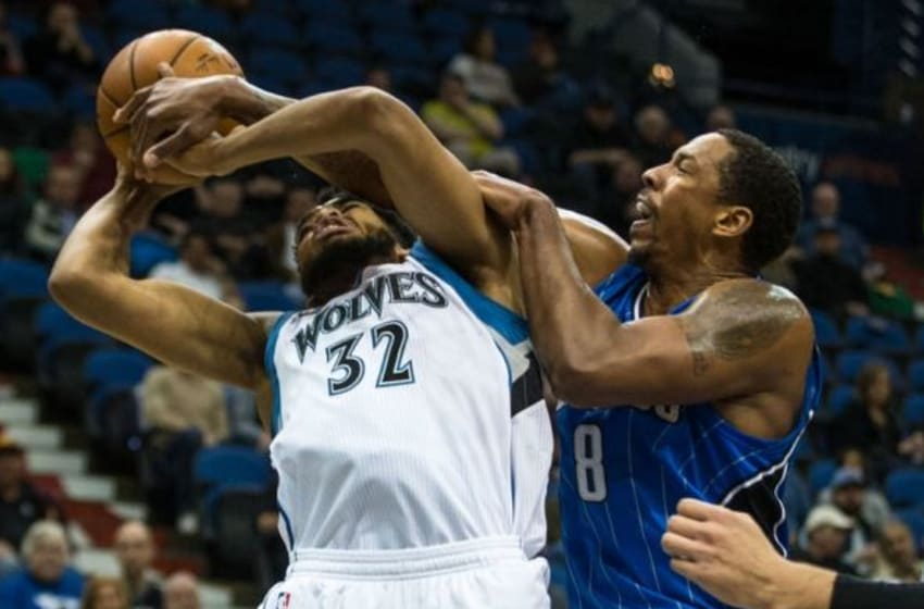 Dec 1, 2015; Minneapolis, MN, USA; Minnesota Timberwolves center Karl-Anthony Towns (32) is fouled by Orlando Magic forward Channing Frye (8) during the third quarter at Target Center. The Magic defeated the Timberwolves 96-93. Mandatory Credit: Brace Hemmelgarn-USA TODAY Sports