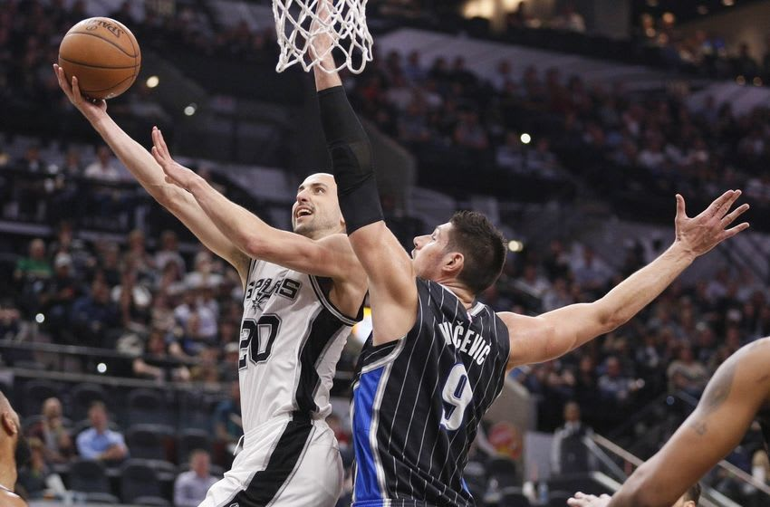 Feb 1, 2016; San Antonio, TX, USA; San Antonio Spurs shooting guard Manu Ginobili (20) shoots as Orlando Magic center Nikola Vucevic (9) defends during the first half at AT&T Center. Mandatory Credit: Soobum Im-USA TODAY Sports