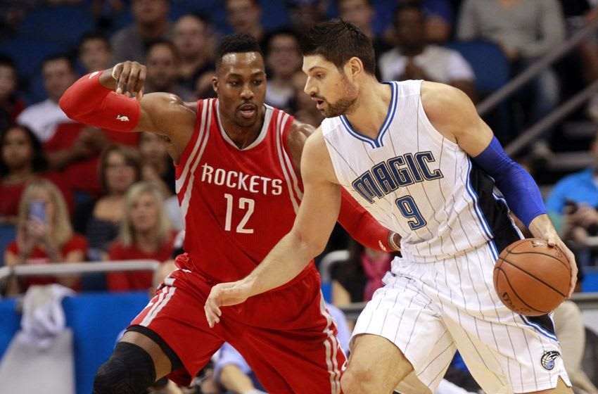 Dec 23, 2015; Orlando, FL, USA; Orlando Magic center Nikola Vucevic (9) drives to the basket as Houston Rockets center Dwight Howard (12) defends during the first quarter at Amway Center. Mandatory Credit: Kim Klement-USA TODAY Sports