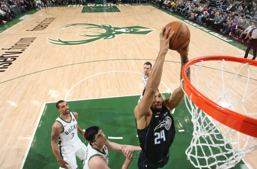 MILWAUKEE, WI - FEBRUARY 9: Khem Birch #24 of the Orlando Magic dunks the ball against the Milwaukee Bucks on February 9, 2019 at the Fiserv Forum Center in Milwaukee, Wisconsin. NOTE TO USER: User expressly acknowledges and agrees that, by downloading and or using this Photograph, user is consenting to the terms and conditions of the Getty Images License Agreement. Mandatory Copyright Notice: Copyright 2019 NBAE (Photo by Gary Dineen/NBAE via Getty Images).