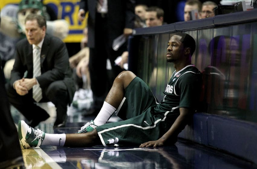 INDIANAPOLIS, IN - MARCH 12: Kalin Lucas #1 of the Michigan State Spartans sits next to the scorer's table against the Penn State Nittany Lions during the semifinals of the 2011 Big Ten Men's Basketball Tournament at Conseco Fieldhouse on March 12, 2011 in Indianapolis, Indiana. Penn State won 61-48. (Photo by Andy Lyons/Getty Images)