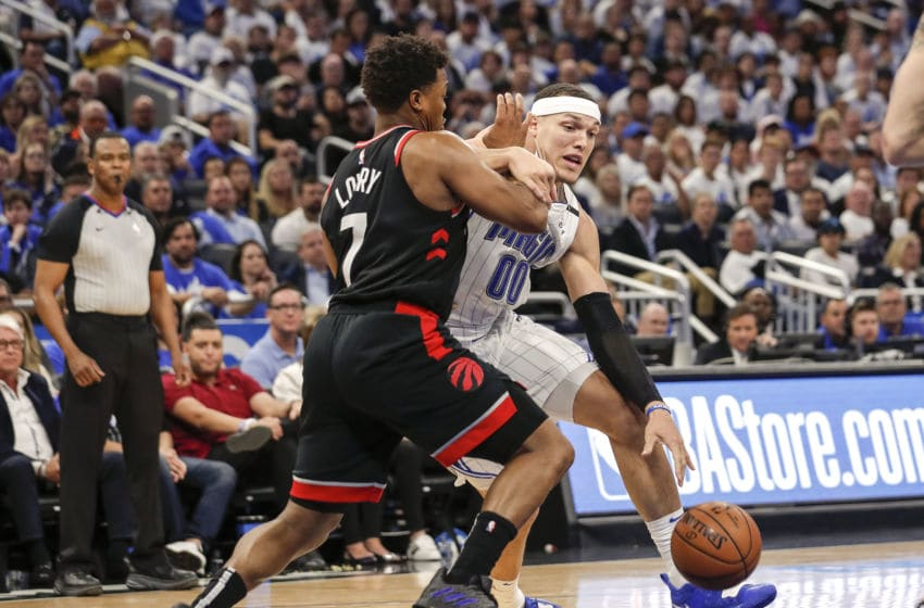 ORLANDO, FL - APRIL 19: Aaron Gordon #00 of the Orlando Magic is gaurded by Kyle Lowry #7 of the Toronto Raptors during Game Three of the first round of the 2019 NBA Eastern Conference Playoffs at the Amway Center on April 19, 2019 in Orlando, Florida. The Raptors defeated the Magic 98 to 93. NOTE TO USER: User expressly acknowledges and agrees that, by downloading and or using this photograph, User is consenting to the terms and conditions of the Getty Images License Agreement. (Photo by Don Juan Moore/Getty Images)