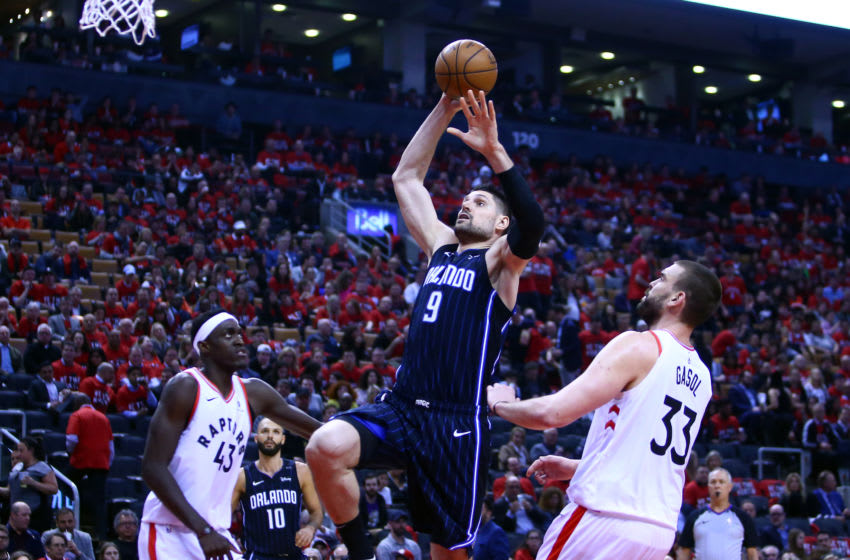 TORONTO, ON - APRIL 23: Nikola Vucevic #9 of the Orlando Magic shoots the ball during Game Five of the first round of the 2019 NBA Playoffs against the Toronto Raptorsat Scotiabank Arena on April 23, 2019 in Toronto, Canada. NOTE TO USER: User expressly acknowledges and agrees that, by downloading and or using this photograph, User is consenting to the terms and conditions of the Getty Images License Agreement. (Photo by Vaughn Ridley/Getty Images)