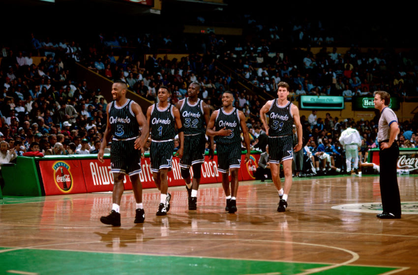 BOSTON, MA - 1994: Dennis Scott #3, Anfernee Hardaway #1, Shaquille O'Neal #32, Nick Anderson #25, and Jeff Turner #31 of the Orlando Magic return to the court during a game played circa 1994 at the Boston Garden in Boston, Massachusetts. NOTE TO USER: User expressly acknowledges and agrees that, by downloading and or using this photograph, User is consenting to the terms and conditions of the Getty Images License Agreement. Mandatory Copyright Notice: Copyright 1994 NBAE (Photo by Dick Raphael/NBAE via Getty Images)