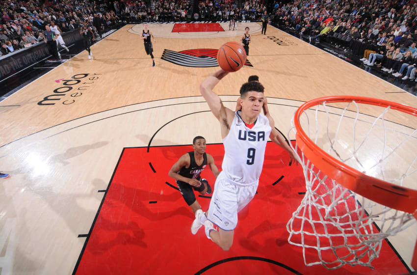PORTLAND, OR - APRIL 7: Michael Porter Jr. #9 of the USA Junior Select Team dunks against the World Select Team during the game on April 7, 2017 at the MODA Center Arena in Portland, Oregon. NOTE TO USER: User expressly acknowledges and agrees that, by downloading and or using this photograph, User is consenting to the terms and conditions of License Agreement. Mandatory Copyright Notice: Copyright 2017 NBAE (Photo by Sam Forencich)