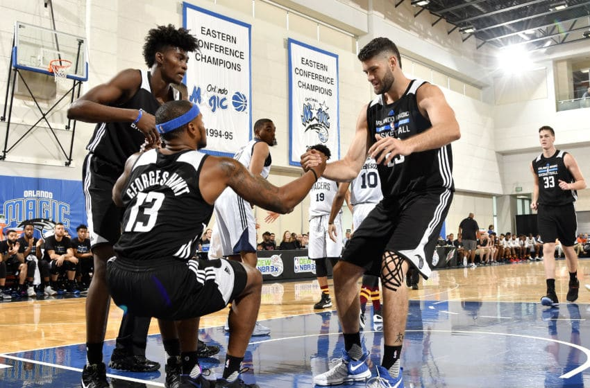ORLANDO, FL - JULY 1: Jonathan Isaac #1 and Patricio Garino #29 help up Marcus Georges-Hunt #13 of the Orlando Magic during the game against the Indiana Pacers during the 2017 Orlando Summer League on July 1, 2017 at Amway Center in Orlando, Florida. NOTE TO USER: User expressly acknowledges and agrees that, by downloading and or using this photograph, User is consenting to the terms and conditions of the Getty Images License Agreement. Mandatory Copyright Notice: Copyright 2015 NBAE (Photo by Fernando Medina/NBAE via Getty Images)