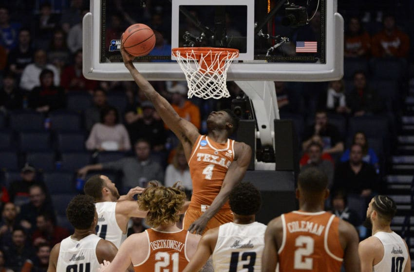 NASHVILLE, TN - MARCH 16: Texas Longhorns forward Mohamed Bamba (4) reverse slams the ball against the Nevada Wolf Pack during the NCAA Division I Men's Championship First Round between the Nevada Wolf Pack on March 16, 2018 and the Texas Longhorns at Bridgestone Arena in Nashville, Tennessee. (Photo by Steve Roberts/Icon Sportswire via Getty Images)