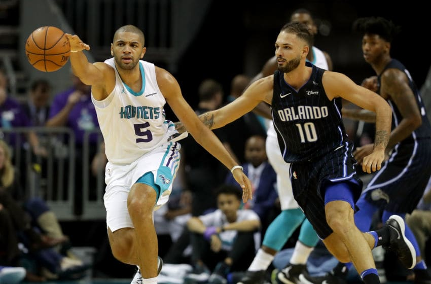 CHARLOTTE, NC - DECEMBER 04: Nicolas Batum #5 of the Charlotte Hornets goes after a loose ball against Evan Fournier #10 of the Orlando Magic during their game at Spectrum Center on December 4, 2017 in Charlotte, North Carolina. NOTE TO USER: User expressly acknowledges and agrees that, by downloading and or using this photograph, User is consenting to the terms and conditions of the Getty Images License Agreement. (Photo by Streeter Lecka/Getty Images)