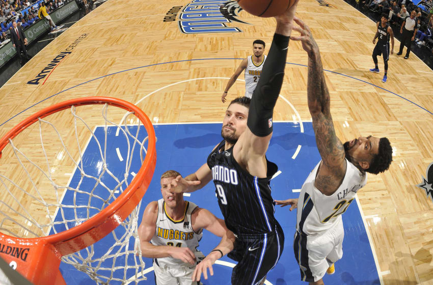 ORLANDO, FL - DECEMBER 8: Nikola Vucevic #9 of the Orlando Magic drives to the basket against the Denver Nuggets on December 8, 2017 at the Amway Center in Orlando, Florida. NOTE TO USER: User expressly acknowledges and agrees that, by downloading and or using this Photograph, user is consenting to the terms and conditions of the Getty Images License Agreement. Mandatory Copyright Notice: Copyright 2017 NBAE (Photo by Fernando Medina/NBAE via Getty Images)