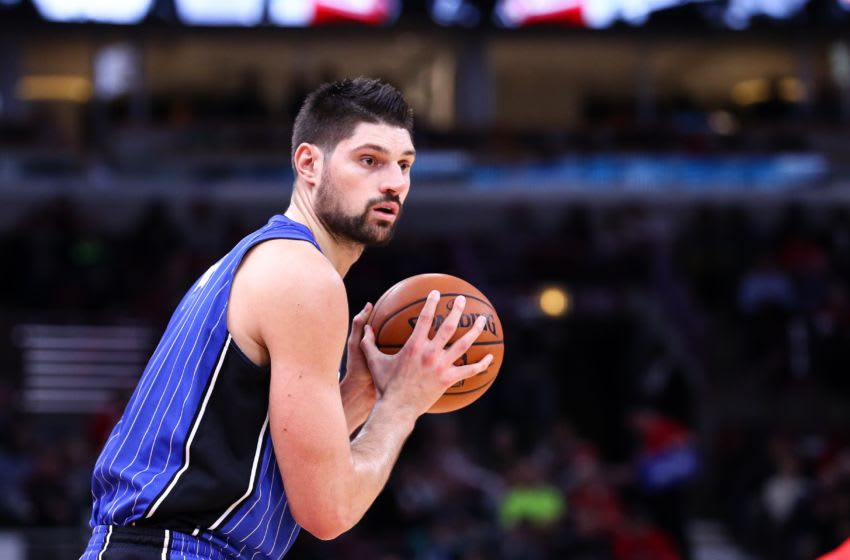 CHICAGO, USA - DECEMBER 20: Nikola Vucevic (9) of Orlando Magic in action during an NBA basketball match between Chicago Bulls and Orlando Magic at United Center in Chicago, Illinois, United States on December 20, 2017. (Photo by Bilgin S. Sasmaz/Anadolu Agency/Getty Images)
