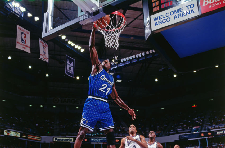 SACRAMENTO, CA - DECEMBER 8: Gerald Wilkens #21 of the Orlando Magic dunks against the Sacramento Kings on December 8, 1996 at Arci Arena in Sacramento, California. NOTE TO USER: User expressly acknowledges and agrees that, by downloading and or using this photograph, User is consenting to the terms and conditions of the Getty Images License Agreement. Mandatory Copyright Notice: Copyright 1996 NBAE (Photo by Rocky Widner/NBAE via Getty Images)