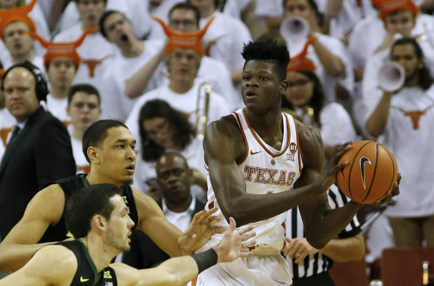 AUSTIN, TX - FEBRUARY 12: Mohamed Bamba #4 of the Texas Longhorns holds the ball away from Tristan Clark #25 (back) and Jake Lindsey #3 (front) of the Baylor Bears at the Frank Erwin Center on February 12, 2018 in Austin, Texas. (Photo by Chris Covatta/Getty Images)