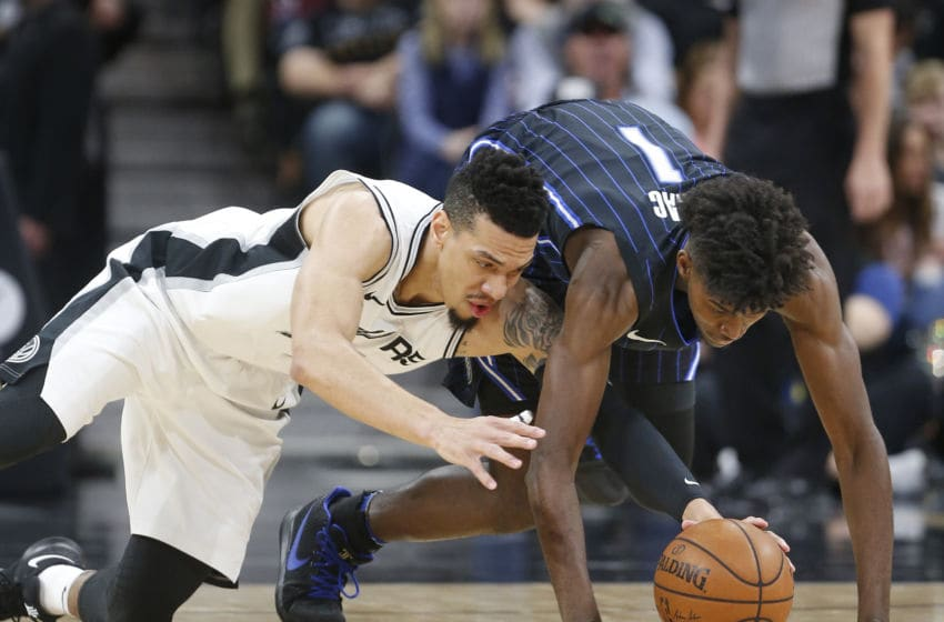 SAN ANTONIO,TX - MARCH 13 : Danny Green #14 of the San Antonio Spurs dives to recover a loose ball from Jonathan Isaac #1j of the Orlando Magic at AT&T Center on March 13, 2018 in San Antonio, Texas. NOTE TO USER: User expressly acknowledges and agrees that , by downloading and or using this photograph, User is consenting to the terms and conditions of the Getty Images License Agreement. (Photo by Ronald Cortes/Getty Images)