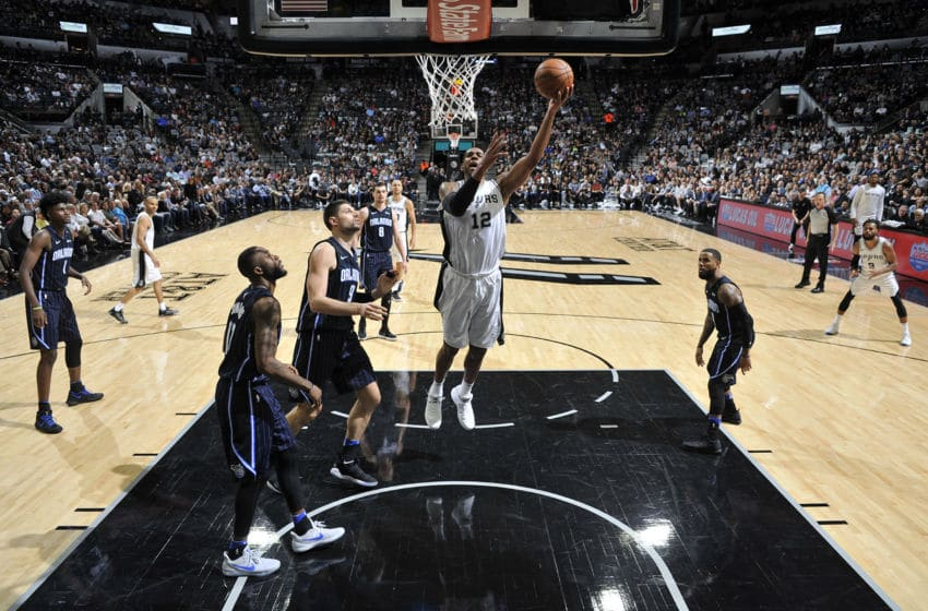 SAN ANTONIO, TX - MARCH 13: LaMarcus Aldridge #12 of the San Antonio Spurs drives to the basket during the game against the Orlando Magic on March 13, 2018 at the AT&T Center in San Antonio, Texas. NOTE TO USER: User expressly acknowledges and agrees that, by downloading and or using this photograph, user is consenting to the terms and conditions of the Getty Images License Agreement. Mandatory Copyright Notice: Copyright 2018 NBAE (Photos by Mark Sobhani/NBAE via Getty Images)
