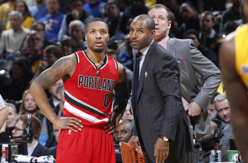 INDIANAPOLIS, IN - DECEMBER 10: Damian Lillard #0 of the Portland Trail Blazers talks to assistant coach David Vanterpool during the game against the Indiana Pacers at Bankers Life Fieldhouse on December 10, 2016 in Indianapolis, Indiana. The Pacers defeated the Trail Blazers 118-111. NOTE TO USER: User expressly acknowledges and agrees that, by downloading and or using the photograph, User is consenting to the terms and conditions of the Getty Images License Agreement. (Photo by Joe Robbins/Getty Images)