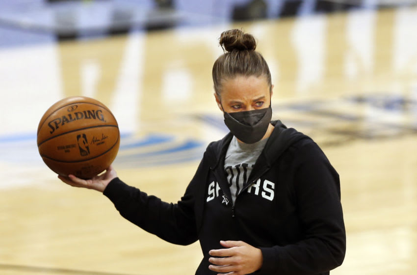 SAN ANTONIO, TX - APRIL 01: Becky Hammond assistant coach of the San Antonio Spurs works with players before their game against the Atlanta Hawks at AT&T Center on April 1, 2021 in San Antonio, Texas. NOTE TO USER: User expressly acknowledges and agrees that , by downloading and or using this photograph, User is consenting to the terms and conditions of the Getty Images License Agreement. (Photo by Ronald Cortes/Getty Images)