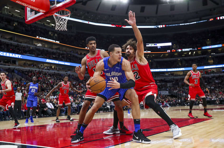 The Chicago Bulls' Shaquille Harrison (3) and Robin Lopez (42) defend against the Orlando Magic's Aaron Gordon (00) during the second half at the United Center in Chicago on Wednesday Jan. 2, 2019. The Magic won, 112-84. (Armando L. Sanchez/Chicago Tribune/TNS via Getty Images)
