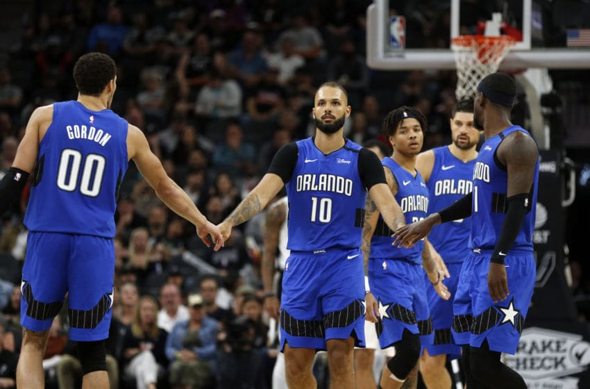 SAN ANTONIO, TX - FEBRUARY 29: Evan Fournier #10 of the Orlando Magic is congratulated by teammates Aaron Gordon #00 and James Ennis III #11 during first half action at AT&T Center on February 29, 2020 in San Antonio, Texas. NOTE TO USER: User expressly acknowledges and agrees that , by downloading and or using this photograph, User is consenting to the terms and conditions of the Getty Images License Agreement. (Photo by Ronald Cortes/Getty Images)