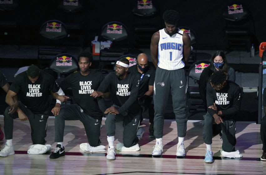 Orlando Magic forward Jonathan Isaac elected to stand during the national anthem, making a statement that stood out around everyone else. (Photo by Ashley Landis - Pool/Getty Images)