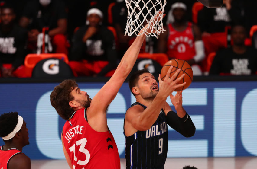 Nikola Vucevic again struggled to break free from Marc Gasol as the Toronto Raptors handled the Orlando Magic yet again. (Photo by Kim Klement-Pool/Getty Images)