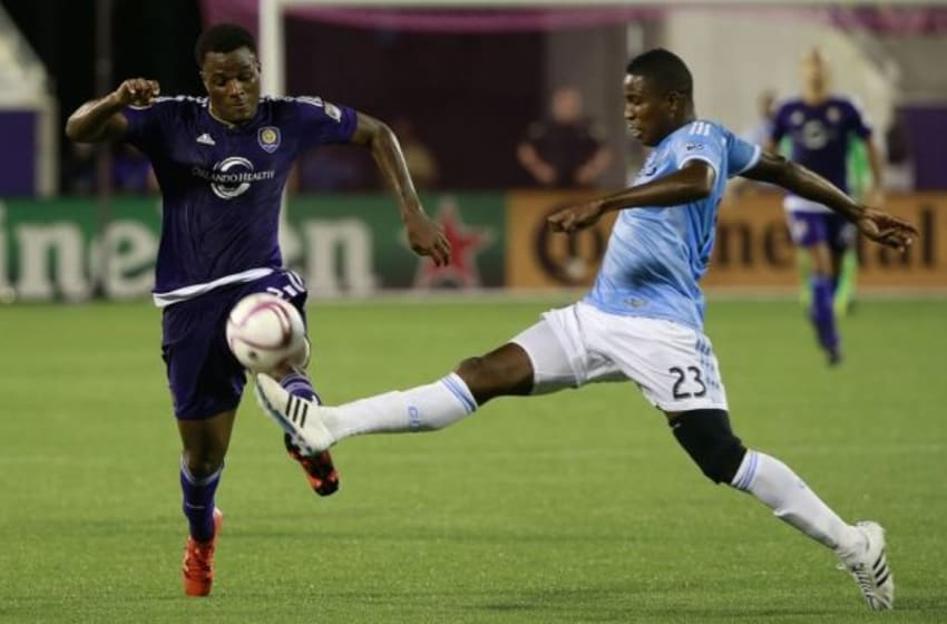 Oct 16, 2015; Orlando, FL, USA;New York City FC defender Jefferson Mena (23) defends Orlando City SC forward Cyle Larin (21) during the second half at Orlando Citrus Bowl Stadium. Orlando City SC won 2-1. Mandatory Credit: Kim Klement-USA TODAY Sports