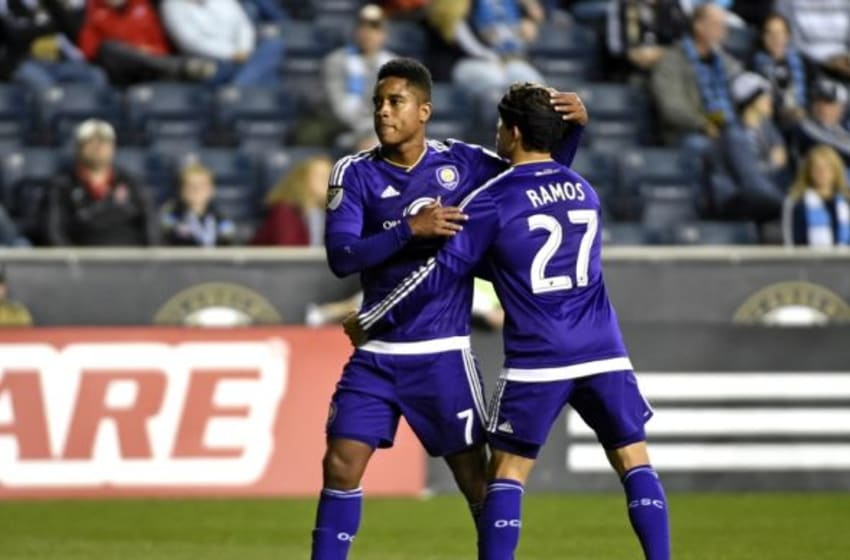 Oct 25, 2015; Philadelphia, PA, USA; Orlando City FC midfielder Cristian Higuita (7) is consoled by defender Rafael Ramos (27) after being ejected against the Philadelphia Union during the second half at PPL Park. The Union defeated Orlando City, 1-0. Mandatory Credit: Eric Hartline-USA TODAY Sports