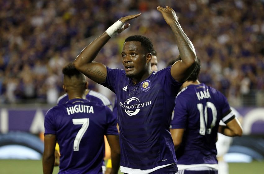 May 21, 2016; Orlando, FL, USA; Orlando City SC forward Cyle Larin (9) celebrates after scoring the game wining goal against the Montreal Impact during the second half at Camping World Stadium. Orlando City SC defeated the Montreal Impact 2-1. Mandatory Credit: Kim Klement-USA TODAY Sports