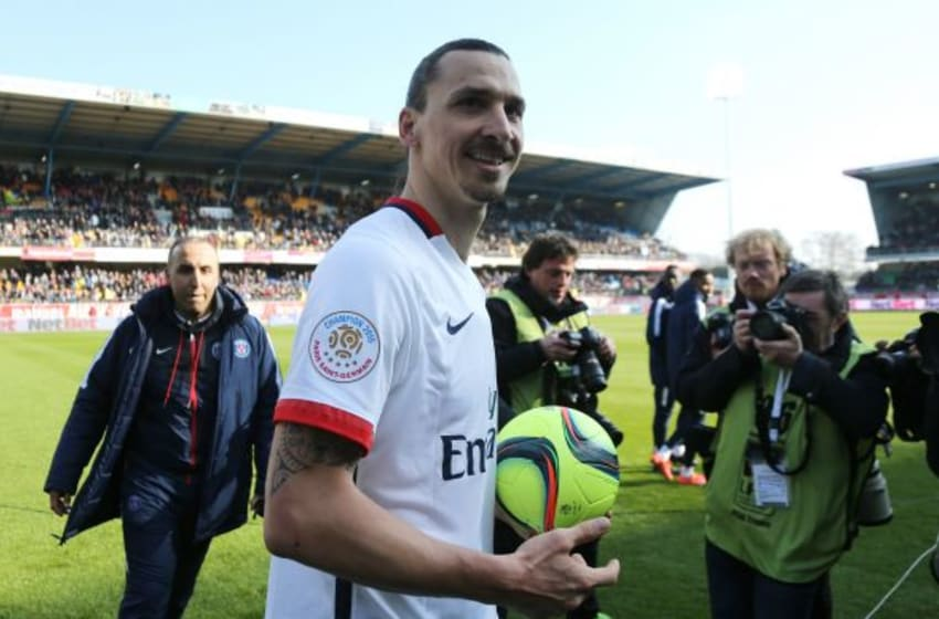 TROYES, FRANCE - MARCH 13: Zlatan Ibrahimovic of PSG keeps the ball of the match because he scored 4 goals while celebrating winning the French League 1 championships 2015-1016 following the French Ligue 1 match between ESTAC Troyes and Paris Saint-Germain (PSG) at Stade de l'Aube on March 13, 2016 in Troyes, France. (Photo by Jean Catuffe/Getty Images)