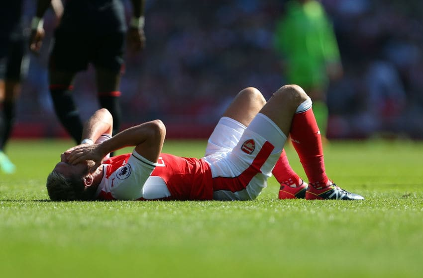 LONDON, ENGLAND - AUGUST 14: An injured Aaron Ramsey of Arsenal during the Premier League match between Arsenal and Liverpool at Emirates Stadium on August 14, 2016 in London, England. (Photo by Catherine Ivill - AMA/Getty Images)