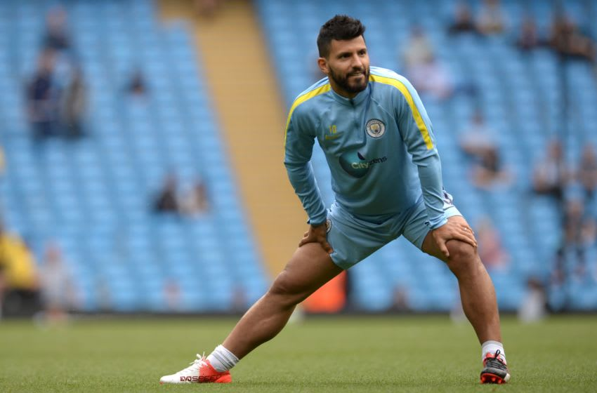 Manchester City's Argentinian striker Sergio Aguero warms up before the English Premier League football match between Manchester City and West Ham United at the Etihad Stadium in Manchester, north west England, on August 28, 2016. / AFP / OLI SCARFF / RESTRICTED TO EDITORIAL USE. No use with unauthorized audio, video, data, fixture lists, club/league logos or 'live' services. Online in-match use limited to 75 images, no video emulation. No use in betting, games or single club/league/player publications. / (Photo credit should read OLI SCARFF/AFP/Getty Images)
