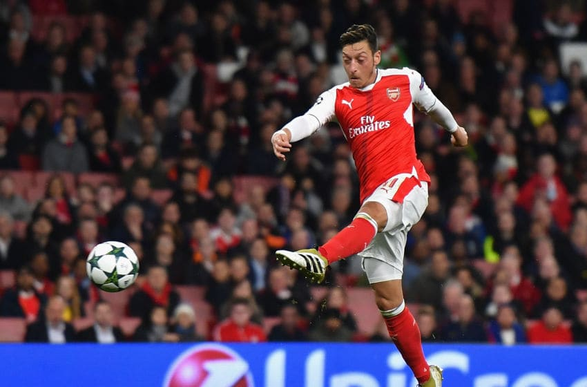 LONDON, ENGLAND - OCTOBER 19: Mesut Ozil of Arsenal scores his team's sixth goal of the game during the UEFA Champions League group A match between Arsenal FC and PFC Ludogorets Razgrad at the Emirates Stadium on October 19, 2016 in London, England. (Photo by Mike Hewitt/Getty Images)