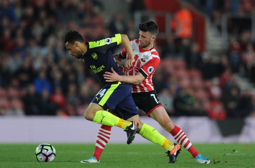 SOUTHAMPTON, ENGLAND - MAY 10: Francis Coquelin of Arsenal is challenged by Shane Long of Southampton during the Premier League match between Southampton and Arsenal at St Mary's Stadium on May 10, 2017 in Southampton, England. (Photo by David Price/Arsenal FC via Getty Images)