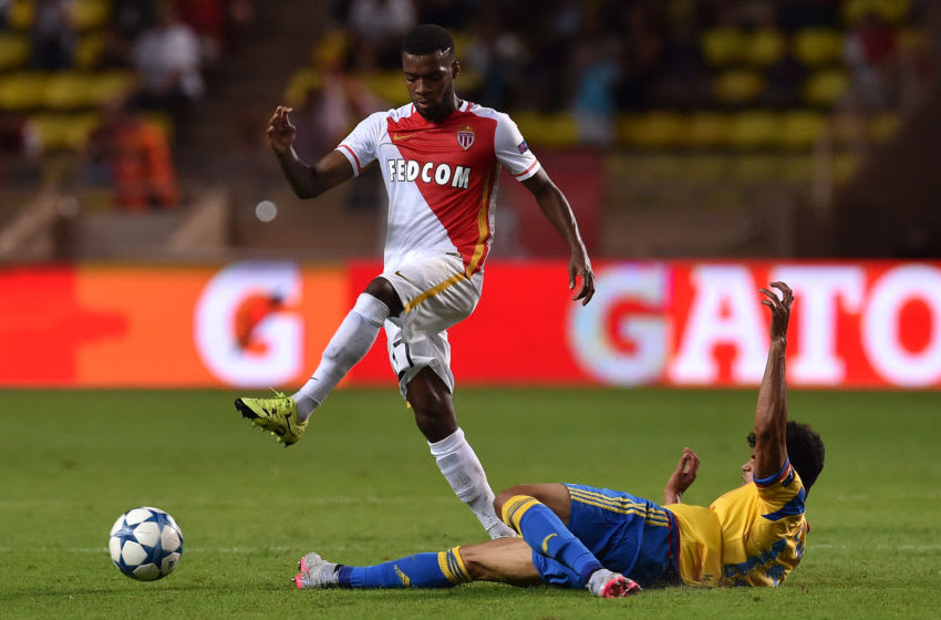 MONACO - AUGUST 25: Thomas Lemar (L) of Monaco is tackled by Danilo Barbosa of Valencia during the UEFA Champions League qualifying round play off second leg match between Monaco and Valencia on August 25, 2015 in Monaco, Monaco. (Photo by Valerio Pennicino/Getty Images)